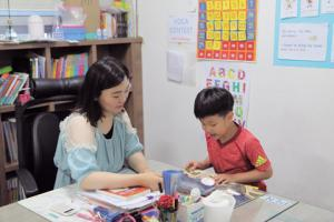 Children learn English better while playing